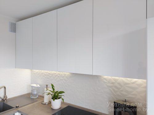 Угловая белая кухня Интегро из крашеного МДФ